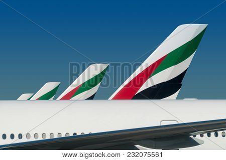 Dubai - December 12, 2017: Emirates Airplane Planes Docked At Dubai International Airport On Decembe