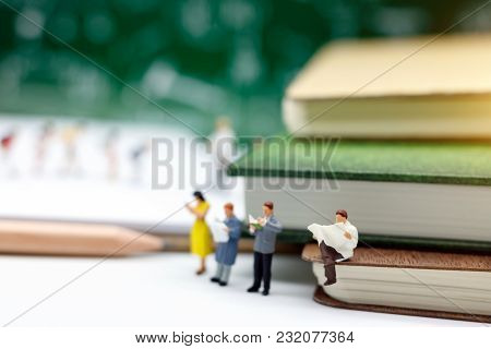 Miniature People: Business Team Sitting On  Book With Pencil. Concept Of Education And Business.