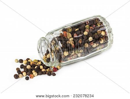 Mixture Of Peppers In Glass Pepperbox Isolated On White