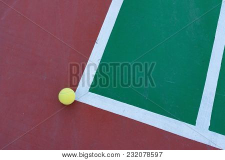 Tennis Ball Just Out Of The Corner Of A Hard Court