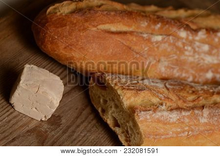 French Bread And Fresh Yeast On Wood Background
