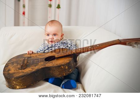 Little Baby Boy With An Old Vintage Guitar