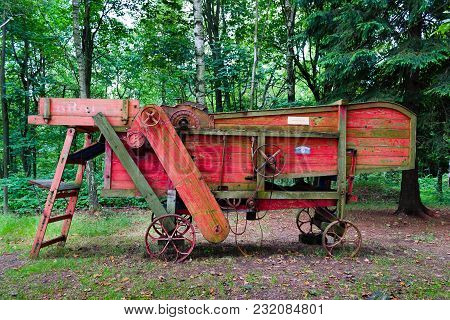 Old Agricultural Thresher Machine Near The Village Prichovice In Czech Republic