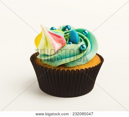 Vanilla Cupcake With Colorful Buttercream Isolated On White Background. Tasty Dessert In Brown Muffi