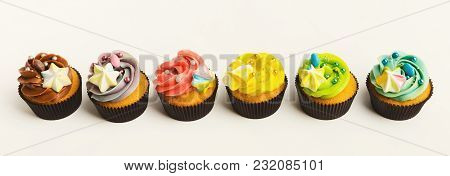 Assortment Of Vanilla Cupcakes With Colorful Buttercream Tops Isolated On White Background. Tasty De