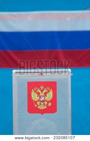 Presidential Election - Voting Box With Ballot Papers In Front Of Russian Flag, Close Up