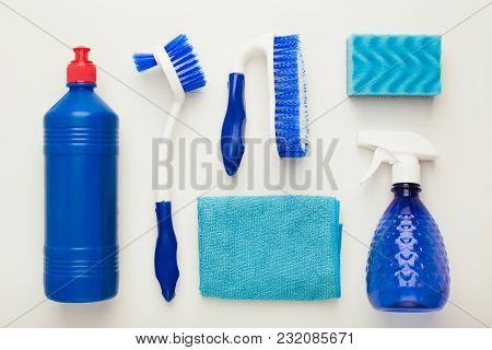 Set Of Blue House Cleaning Products And Supplies On White Isolated Background, Top View. Spring Clea