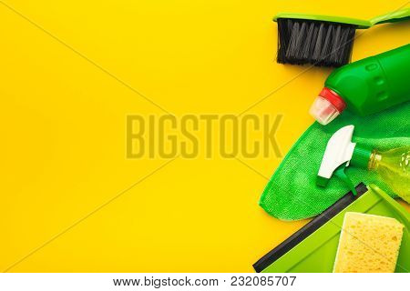House Cleaning Products And Supplies On Yellow Isolated Background, Top View. Spring Cleaning And Ho