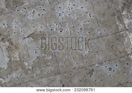 A Thin Skim Of Ice On The Pavement, Spring Background, Abstract Image.