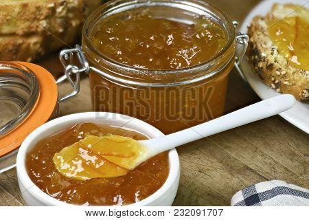 Homemade Organic Marmalade In A Small White Dish With Larger Amount In A Preserving Jar Laid Out On