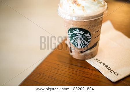 Bangkok, Thailand - January 30, 2018 :  Ice Frappuccino (cappuccino & Frappe) On Brown Table With Ti