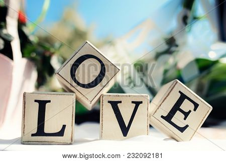 Love Message Written In Wooden Blocks. Wedding Decoration
