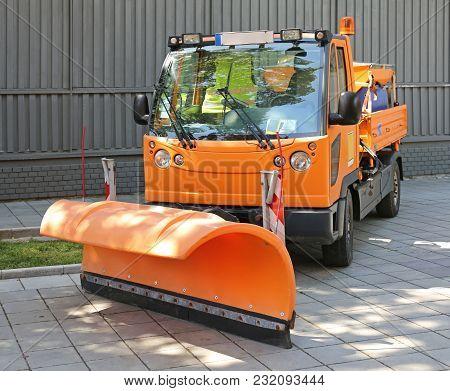 Snow Plow At Orange Truck For Road Maintenance