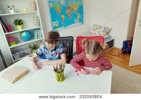 Two Cute Children Drawing With Colorful Pencils