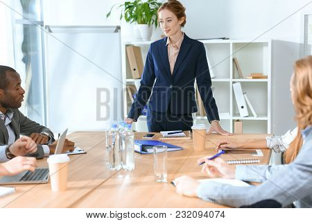 View Of Multicultural Businesspeople Discussing Something At Meeting