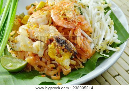 Pad Thai Stir Fried Rice Noodles With Shrimp And Squid On White Plate