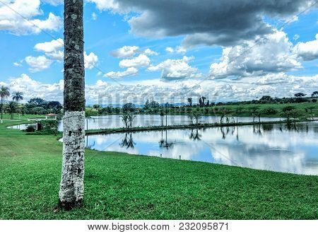 Natural Resort With Water Mirror Refleccting The Blue Sky With Clouds, In São João Da Boa Vista, In