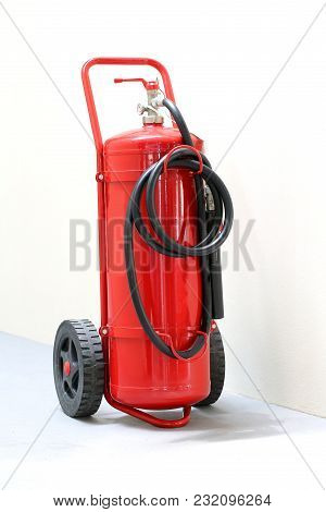 Big Wheeled Fire Extinguisher With Black Pipe