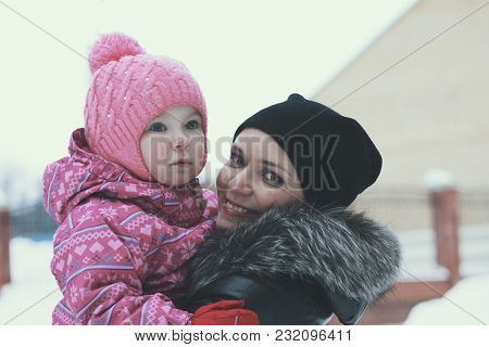 Portrait Of A Cute Little Girl Walking With Her Mother On Winter Street, Winter Family Entertainment