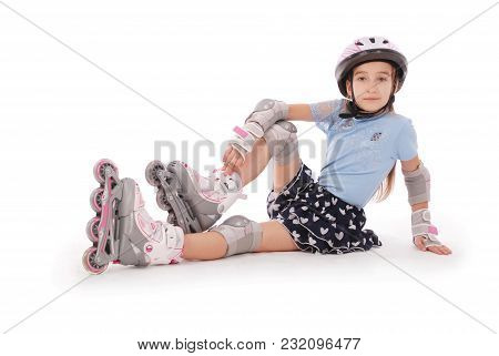 Happy Little Girl With Roller Skates And Protective Gear Resting - Isolated On White Background