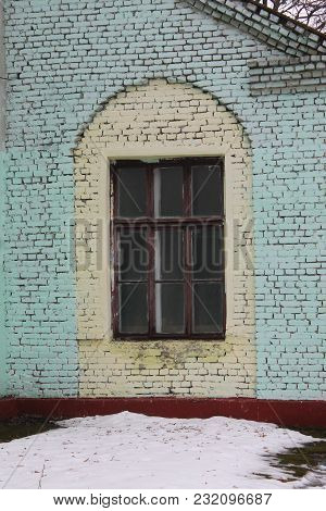 Retro Style Framed Window Shared On Nine Parts In Arch Brick Wall