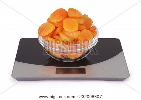 Dried Apricot On Kitchen Scale Isolated On White Background.