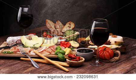 Italian Antipasti Wine Snacks Set. Cheese Variety, Mediterranean Olives, Pickles, Prosciutto Di Parm