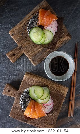 Sushi Donuts Set With Salmon, Vegetarian With Soy Sauce. Sushi Trend. Creative Food. Dark Background