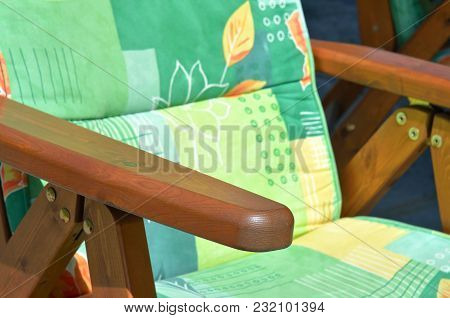 Brown Wooden Garden Deckchair With A Green Cloth