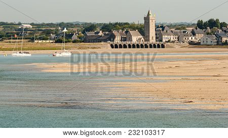 Sandy Beach, Low Tide And Village Of Portbail In Normandy France, Sunny Day In Summer