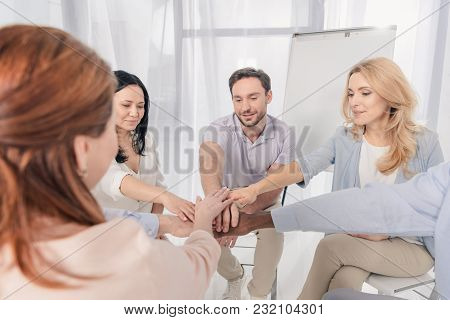 Cropped Shot Of Middle Aged Multiethnic People Stacking Hands During Group Therapy