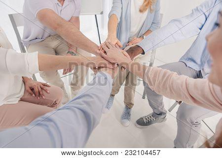 Cropped Shot Of People Stacking Hands During Group Therapy
