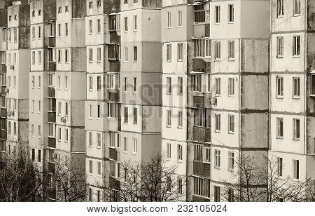 Autumn Day. In The Frame, A Gray Gray Old Multi-story House. Photographed In Ukraine, Kiev. Black An