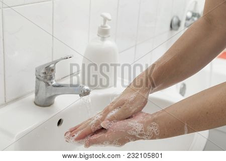 Close Up Of A Woman Washing Hands. Selective Focus On The Hand
