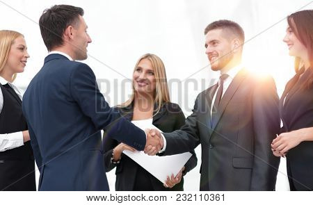 closeup of handshake of business partners on the background of b