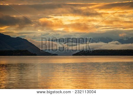 Firely Sunrise With Clouds At Naknek Lake In Brooks Falls Camp In Alaska, Twilight Above Mountains R