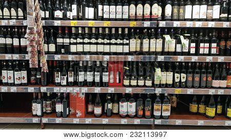 Piatra Neamt, Romania - March 16: Wine Bottles In A Store Shelf, Supermarket Aisle In Shopping Cente