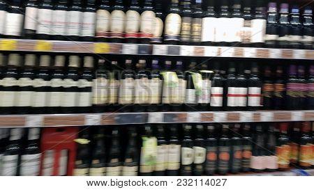 Wine Bottles In A Store Shelf, Supermarket Aisle