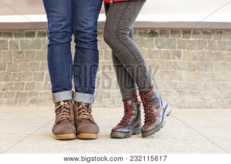 Stylish couple in comfortable shoes on city street