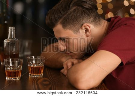 Drunk man in bar. Alcoholism problem