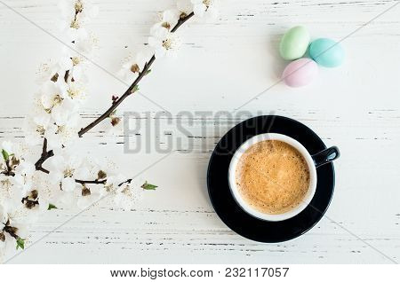 Cup Of Coffee Espresso, Colorful Chocolate Eggs And Cherry Blossom On White Shabby Chic Background.