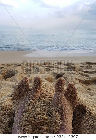 Photo Of Feet In Sand On Sea Coast During Day