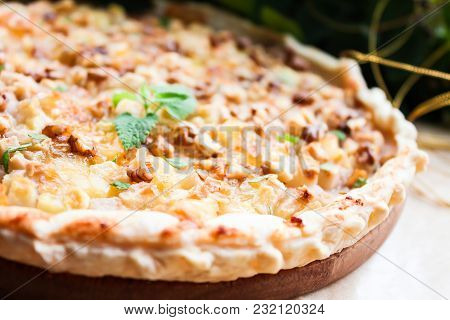 Homemade Puff Pastry Pie Or Pizza With Camembert Cheese, Conference Pears, Walnuts And Fresh Mint, S