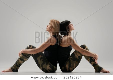 Two Athletic Healthy Women Sitting After Fitness Exercises