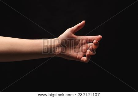 Tender Female Helping Hand On Black Background, Isolated. Woman Stretching Hand To Show Or Ask For S