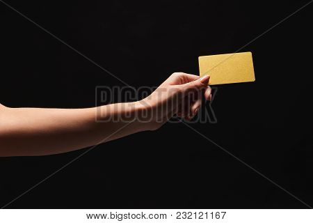 Female Hand Holding Blank Plastic Credit Card Or Business Card On Black Isolated Studio Background.