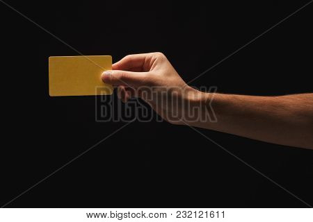 Male Hand Holding Blank Plastic Credit Card Or Business Card On Black Isolated Studio Background. Ba