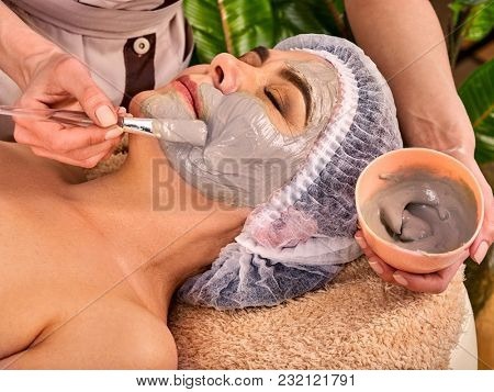 Collagen face mask. Facial skin treatment. Face of woman of elderly woman 50-60 years old receiving cosmetic procedure in beauty salon close up. Professional cosmetologist. Removal of pigmented spots.