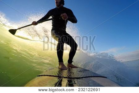 Standup Paddle Board Surfer Silhouette Surfing A Green Wave