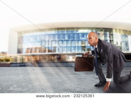Businessman With Briefcase In Hand Ready To Race